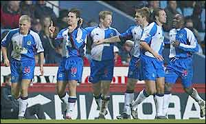 Jansen (second left) celebrates his second strike with his Blackburn colleagues