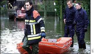 Fireman tows dinghy filled with sandbags in Belgium