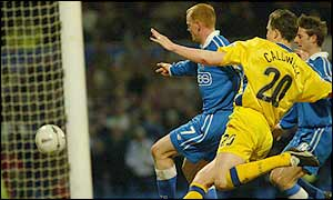 Cardiff striker Andy Campbell scores the equaliser against Coventry