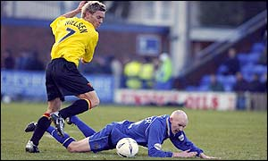 Macclesfield's Danny Whitaker is fouled by Watford's Allan Nielsen
