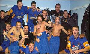 Shrewsbury's players celebrate their win