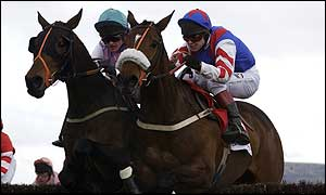 Joe Tizzard (left) rides See More Business in the 2002 Cheltenham Gold Cup