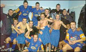 Shrewsbury celebrate their FA Cup giantkilling win over Everton
