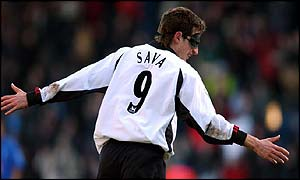 Fernando Sava celebrates his goal against Birmingham with his trademark black mask