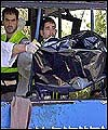 A body is taken from a bombed bus