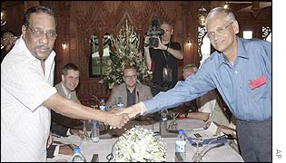 Chief rebel negotiator Anton Balasingham with government negotiator GL Peiris in Thailand