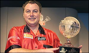 John Part poses with the PDC World Darts Championship trophy