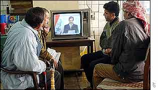 Iraqis watching Saddam Hussein's speech on TV