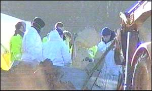 Investigators at the crash scene