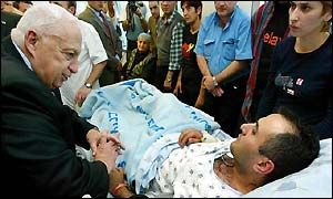 Israeli Prime Minister Ariel Sharon visits the wounded in a Tel Aviv hospital