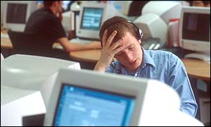A male worker in front of his computer screen