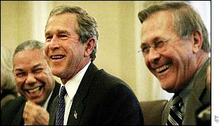 George W Bush shares a laugh with Donald Rumsfeld and Colin Powell