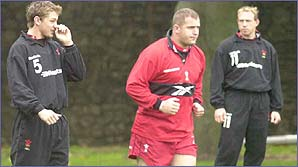The Welsh players always warm up before training
