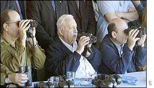 Prime Minister Ariel Sharon (centre) watches an army exercise on Tuesday