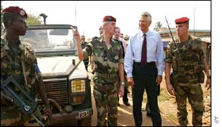 French Foreign Minister Dominique de Villepin, second right, visits a French army post in Ivory Coast