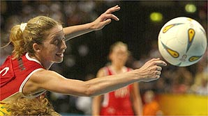 Olivia pushes the ball away from her Australian opposition