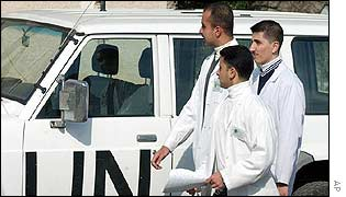 Medical students pass a UN car at the Saddam Medical College