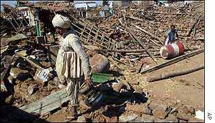 Man stands in rubble after Gujarat earthquake 2001