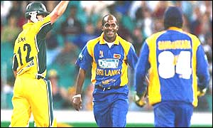 Sanath Jayasuriya (centre) celebrates taking a wicket