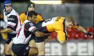 Emile Ntamack tackles Matt Mostyn