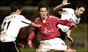 Derby's Chris Riggott (left) and Malcolm Christie tangle with Charlton's Scott Parker