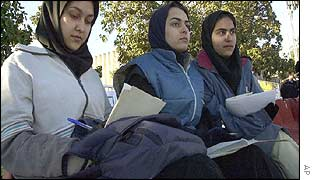 Women journalists take notes at the Iran Khodro stadium during the Paykan-Barq of Shiraz game