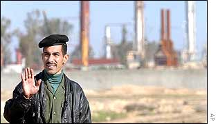 An Iraqi soldier stops journalists at a natural gas plant