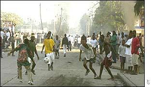 Haitian protestors playing football