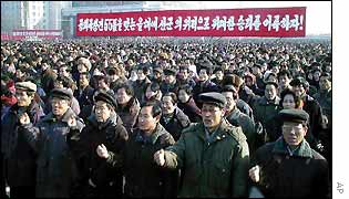 Thousands of North Koreans rally in Pyongyang. Banner reads: