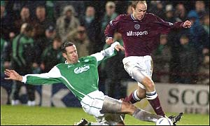 Derek Townley tackles Neil Macfarlane in the Edinburgh derby