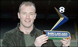 Alan Shearer shows off his Barclaycard Premiership player of the month award