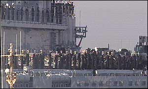 Troops wave from Ark Royal aircraft carrier