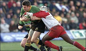 Northampton's John Leslie is tackled by Biarritz's Serge Betsen