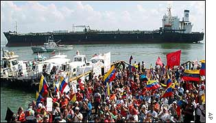 Oil workers rally in front of strike-bound tanker