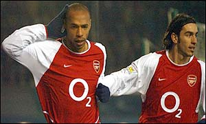 Arsenal goalscores Thierry Henry and Robert Pires celebrate
