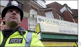 Policeman on guard outside Wood Green pharmacy