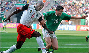 Raymond Kalla tackles Robbie Keane during the 2002 World Cup