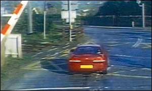 Car running a red light at Kirknewton level crossing