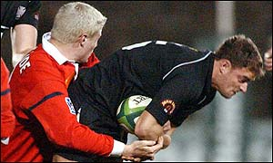 Neath's Adrian Durston is held by Jean-Phillipe Grandeclaude