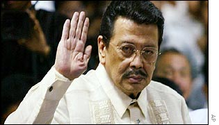 Former Philippines President Joseph Estrada takes an oath before testifying