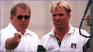 Terry Jenner gives instructions to Shane Warne