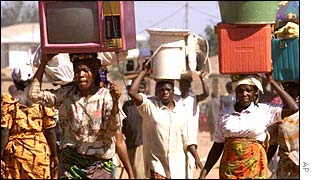 Nigeria people carrying belongings on head