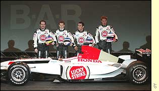 Race drivers Jacques Villeneuve and Jenson Button flank test drivers Anthony Davidson and Takuma Sato