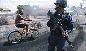 Armed policeman and cyclist