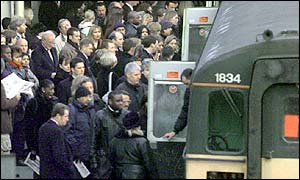 Commuters board a train