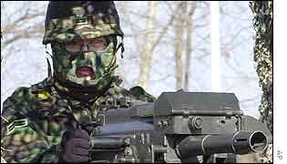 A gunner mans an armoured vehicle during a military exercise in Paju, near the demilitarized zone (DMZ),