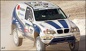 BMW driver Luc Alphand of France jumps over a sand dune