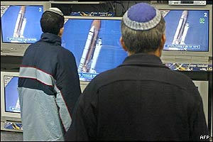 Israeli men watch the launch from the Kennedy Space center