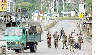 Security forces patrol Imphal street