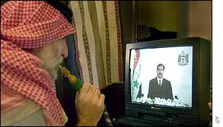 Man watches speech in Kuwait